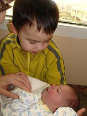 Nathan holding Adam