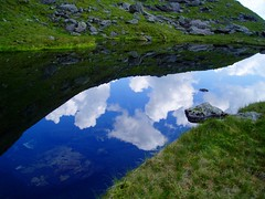 mountain tarn with clouds photo by torpenhow3