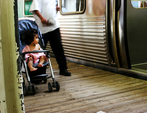 Toddler waiting with her mom on the El platform near the Art Institute of Chicago