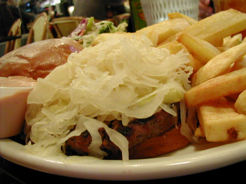 mountain of sauerkraut camouflaging a humongous burger