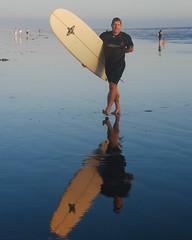longboarder glassy reflection photo by jst images