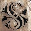S cutout rusting metal
