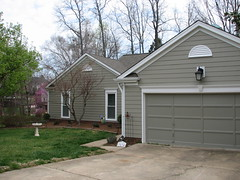 Hardiplank Colorplus Siding w Garage Door Header photo by CrownBuilders