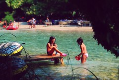 girls playing in the river photo by andreas n