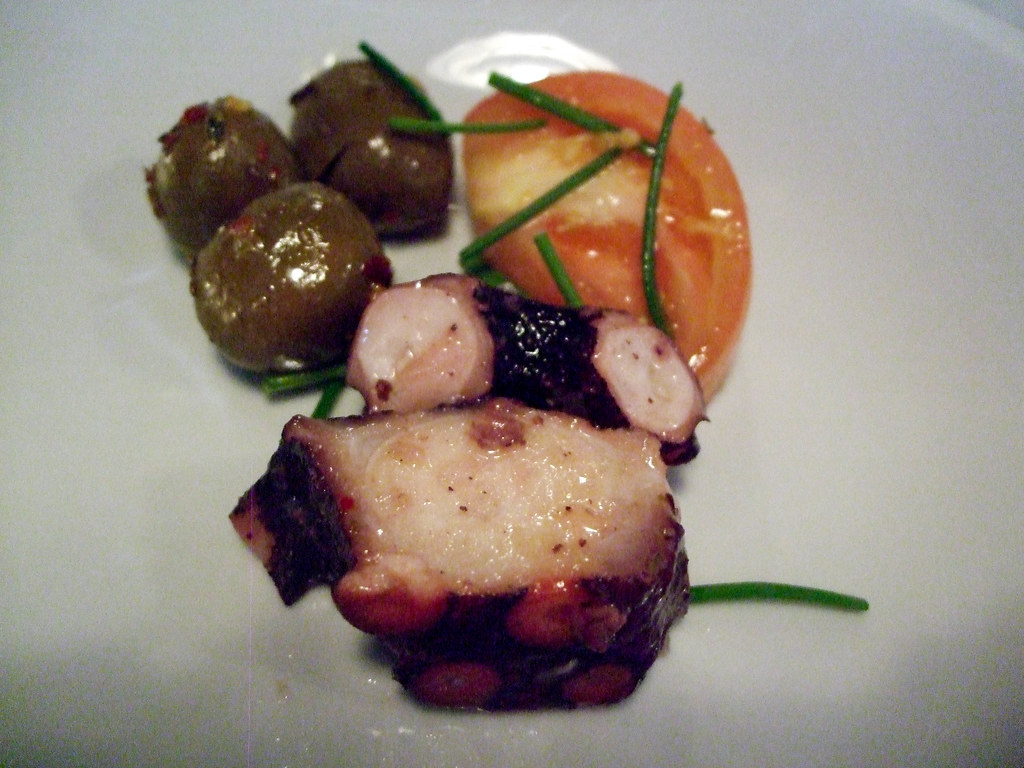 An Appetizer of Octopus, Olives, Tomatoes and Rosemary