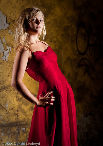 Fanny Strand showing an evening dress in abandoned factory, Katrineholm, Sweden