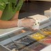Qoola's staff preparing my yogurt