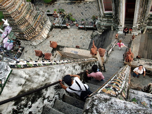 climbing down wat arun stairs