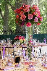 Tall Trumet Vase Arrangement with Purple Flowers photo by NY Engagements LLC