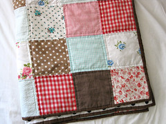 folded baby quilt photo by sparklecandace