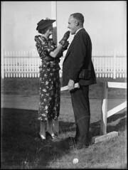 Man and woman at Warwick Farm racecourse photo by Powerhouse Museum Collection