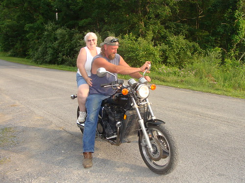 Margaret riding on a motorcycle in front of Sher's iwith daughter Sherri's brother-in-law Chris