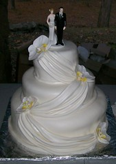 Orchid and drape wedding cake photo by gigiscakeboutique