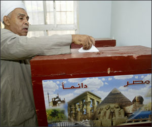 An Egytian voter casts his ballot at a p