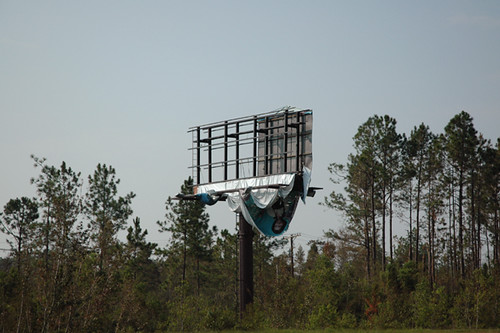 billboard with woman hanging down 16-1web