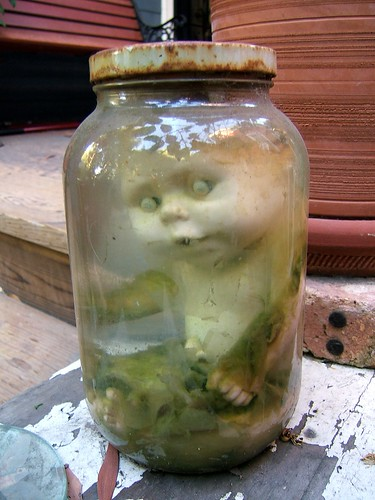 snopes.com: A doll in a jar?