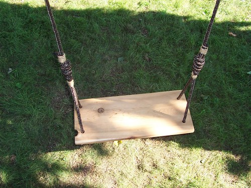 classic wooden tree swing
