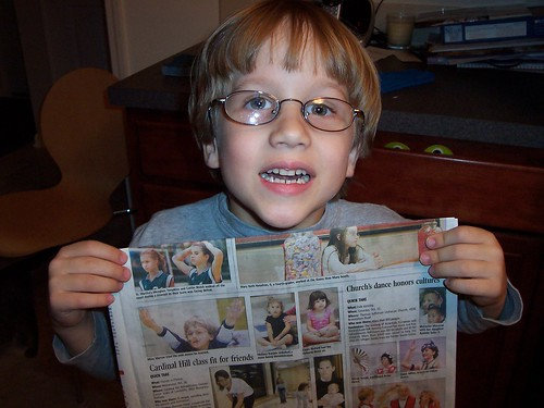 Miles holding his article