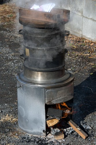 rice being steamed on an outdoor stove