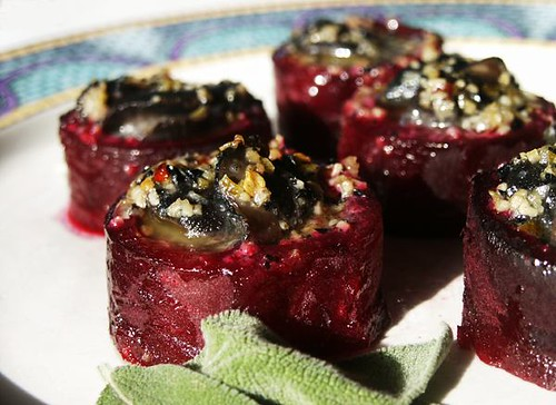 Snails in beet cups with truffle butter