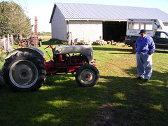 A farmer checking out grandpa's tractor