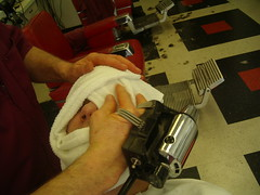 A finishing hot towel and mechanical face massage