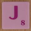 Scrabble pink tile letter J