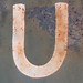U white paint on blue - rusting