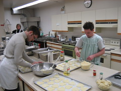 Adding different cheeses to the tarts