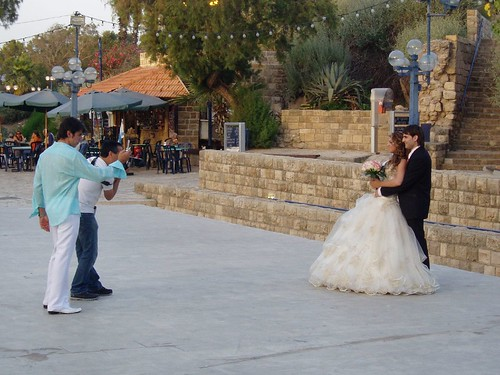 A newly wed posing for pictures in Jaffa city