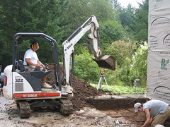 Mark at Tight Access Excavating, with our helper, a local high school student named Michael