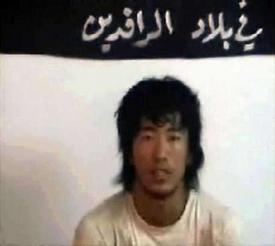 An unidentified Japanese hostage is seen seated in a still image taken from an internet video broadcast on October 26, 2004. Al Qaeda ally Abu Musab al-Zarqawi's militant group threatened to behead the hostage it said worked with Japan's forces in Iraq if Tokyo did not withdraw its troops from the country within 48 hours. Photo by Reuters (Handout)