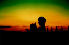 Reggae sunset: a girl with a dog photo by Kokosmeli