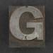 Caslon metal type letter G