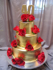 gold ganache 3 tier 40th birthday cake with red roses photo by Charly's Bakery