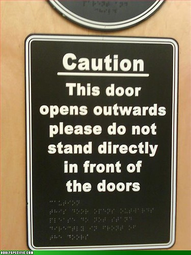 sign with Braille warning not to go near door