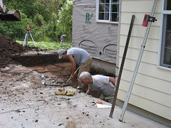 Michael Stone helping with the excavating - he's the one on the right, without any color in his hair