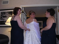 The girls cinching up my dress