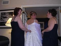 The girls cinching up my dress