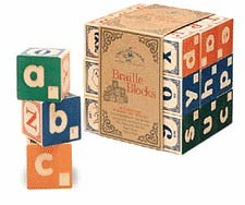 children's style colourful wooden blocks with the letters of the alphabet printed on them in Braille and Roman