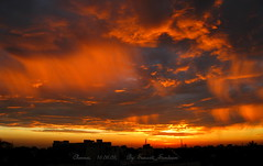 Firing clouds and fiery sky.  A dawn scene from my window photo by Sunciti _ Sundaram's Images + Messages