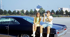 My sister and I (with the requisite Kodak Instamatic X-15 camera) sit on my Dad's 1965 Pontiac Bonneville in a parking lot at JFK airport. Queens, New York. July 1972 photo by wavz13