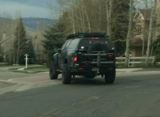 Maybe hang up so you can use turn signals and not swerve all over the road.