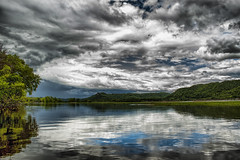 Bright Blue Reflection Hidden Behind Gray Clouds photo by Gary.Lamprecht