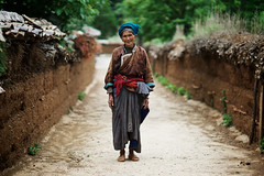 Real Mosuo old woman in village around Lugu lake photo by Alex_Saurel