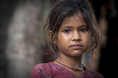 #22 Children Faces. Young deep eyes...   New Delhi   India photo by Daniele Romeo