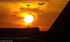 Sunset at JFK Airport / Coucher de soleil sur l'aéroport JFK photo by PULLKATT PHOTOGRAPHY
