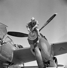 1942 ... mechanic with P-38 photo by x-ray delta one