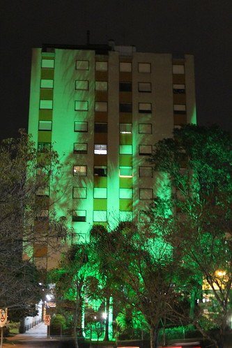 Building with green lights on it.