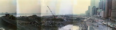 Battery Park City landfill construction, West Street, West Side Highway, The World Trade Center. Lower West Side as it appeared from the Pier A fire escape in March 1975. New York. photo by wavz13